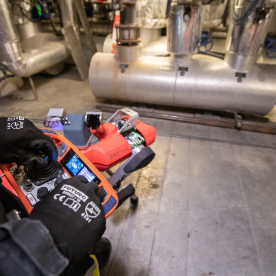 ANYmal C legged robot operator with joystick close-up