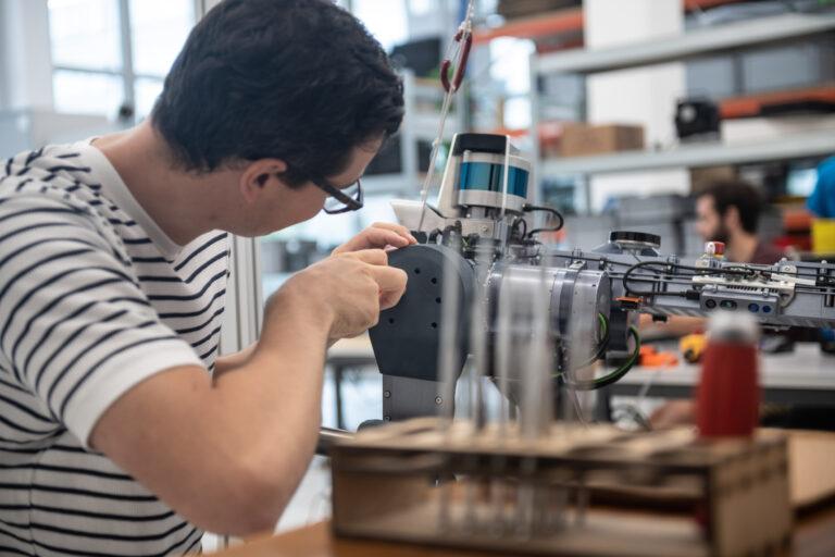 Mechanic working on legged robot